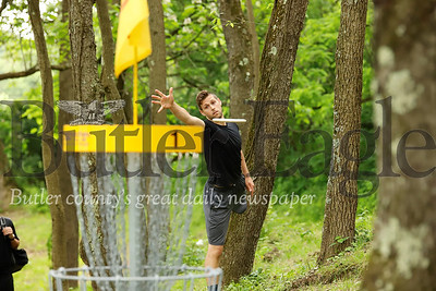 Pittsburgh Penguins goalie Casey DeSmith tosses a disc toward the first basket on the disc golf course at Cranberry's North Boundary Park over the weekend. DeSmith, an avid disc golfer, was among those on hand for the ribbon cutting ceremonies for the official course grand opening Saturday. Seb Foltz/ Butler Eagle