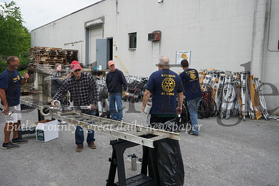 Photo by J.W. Johnson Jr.Members of the Rich-Mar Rotary Satellite Club work Saturday to package crutches and walkers for donation.