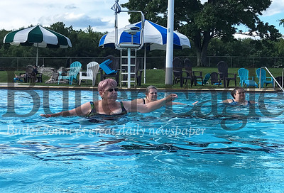 (From left to right) Sue Draper, Linda Thoma and Debbie Switzer perform a series of movements during water aerobics at Alameda Waterpark. Photo by Gabriella Canales.