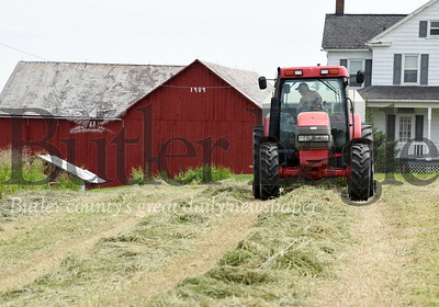 Harold Aughton/Butler Eagle: Guy Daubenspeck of Connoquennesing made approximately 50-round bales of hay while the sun shined last week. Daubenspeck has only been able to cut 10 of his 50 acres of hay due to the weather.