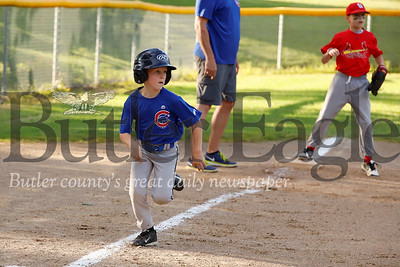 Will Graper breaks for home to score in the Saxonburg 7-8 year-old little league championship game between the Cubs and the Cardinals Friday, June 14, at Laura Doerr Park. The Cardinals went on to win 13-4.  Seb Foltz/Butler Eagle