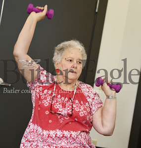 Harold Aughton/Butler Eagle: Diane Hyatt of Harrisville participates in the Geri-Fit exercise program at the Slippery Rock Community Library.