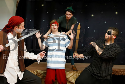 Peter Pan (Shadowlynn Reges-Pollarine) tussles with Neverland pirates Starkey (Ian Reitemeyer), Smee (Victor Eberle) and Mullens (Christian Baughman). Seb Foltz/Butler Eagle