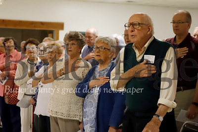 100-year-old Butler resident John Mahler (front right) stands for the pledge of alegiance along with other inductees into the Butler voting hall of fame Friday, June 21. Mahler hasn't missed an opportunity to vote in 75 years. To qualify, award recipients had to continuously vote for a minimum of 50 years. Some exceptions were made for Vietnam vets who may not have been able to vote absentee during the war. Seb Foltz/Butler Eagle