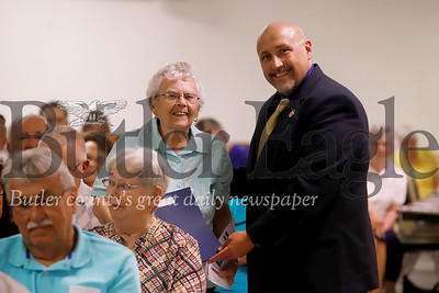 Nancy Stowe, 89, of Butler recieves a voting hall of tame award from Kevin Boozel, Butler County commisioner. In addition to a stelar voting record, Stowe assisted at poling stations for 65 years.