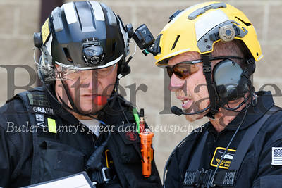 Harold Aughton/Butler Eagle: Scott Grahn, Pennsylvania Helicopter Aquatic Rescue Team, and BC3 professor Chris Calhoun go over the operations plan during Thursday's rescue training mission at the community college.