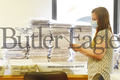 Harold Aughton/Butler Eagle: Chantell McCurdy, register for the Butler County Election Bureau, sorts through mail-in and absentee ballots Tuesday, June 2, 2020.