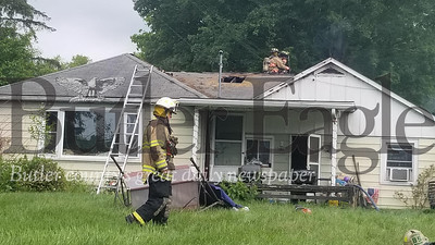Firefighters check a home after battling a house fire at about 10:10 a.m. Tuesday on East Mercer Street in Harrisville. Jim Smith/Butler Eagle  June 2, 2020
