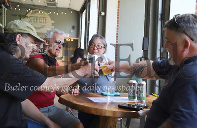 Stick City Brewing Company regulars Curtis Bowers (left) and Kevin Lynch of Mars, and Lynne and Bill Bowers of Sarver toast to being back at one of their favorite spots. With restaurants across the county reopening guests appeared eager to a return to some sense of normalcy. Seb Foltz/Butler Eagle