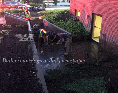 A geyser gushed from a water main break across the street from the Armstrong customer service center building located at 437 North Main Street in Butler Monday, June 15, 2020. photo 4