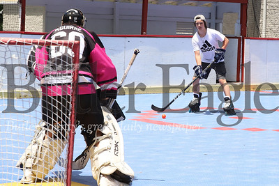 (EDITOR'S NOTE: RELATED TO COUNTY FUNDING STORY)  Aaron Shoup takes a shot against  goalie Matt Aguirre Tuesday at Butler Township's deck hockey rink in Butler Township Park. The two were practicing with teammates from their club team, the Beauts HC, part of an under 18 team league at the Family Sport Center.  Seb Foltz/Butler Eagle