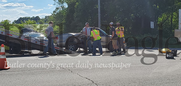 An accident on Route 8 sent two riders of a motorcycle to the hospital after they collided with the side of a truck. Nathan Bottiger/Butler Eagle photo 2