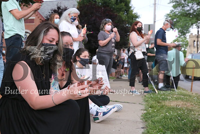 Loredana Yenick (left) and Laura McClaine kneel in silence as part of an 8 minute 46 second moment of silence in observance of George Floyd. Around 100 protesters lined the street corners at the intersection of Grandview Ave and Route 19 in Zeilienople Park Wednesday evening for a candle light vigil promoting the Black Lives Matter movement. Seb Foltz/Butler Eagle