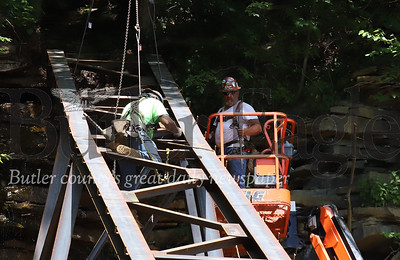 Construction workers install a drainage sluice above the Armstrong Trail tunnel Wednesday 06/17/20. Seb Foltz/Butler Eagle