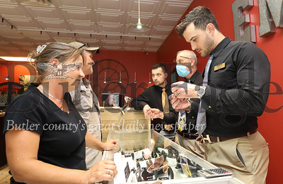 Zach Emigh of Emigh Jewlery Co. assists Beth Yost with a jewelry question Thursday.The family owned jewler has decided to follow any safety protocol their customers feel necesary. Seb Foltz/Butler Eagle 06/18/20