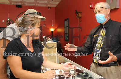 Bob Emigh of Emigh Jewlery Co. assists Beth Yost at his store Thursday. Seb Foltz/Butler Eagle 06/18/20