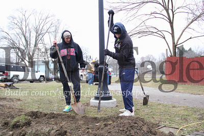 A.I.R. Help with pavilion 733Misty Miller of Butler, left, and James Cunningham of Zelienople, right, both members of Action in Recovery (A.I.R)  are working to dig down for a line that will lead to the pavilion being built in Island Park early in the morning on March 2, 2019. Photos by Lauryn Halahurich/Butler Eagle