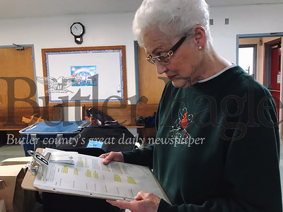 Butler resident Peggy Loomis looks over her delivery schedule for Butler Meals on Wheels on Tuesday.