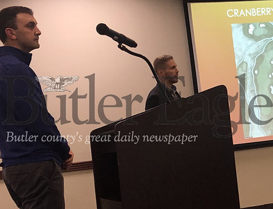1:Photo by J.W. Johnson Jr.From left, Matt Krepp, Cranberry Highlands Golf Course assistant superintendent, and Mason Miller of the Cranberry Township Public Works Department, present plans for an apiary to township supervisors.