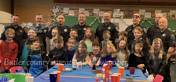 Third grade students at Rowan Elementary School pose with Cranberry Township police officers after feeding them pancakes, smoothies, coffee and more at their breakfast with cops event Wednesday morning. Photos by Alexandria Mansfield.
