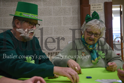 Christ Community United Methodist Church members Mike and Linda Carrigan, of Meridian, put down game chips during St. Patrick Game Night on Sunday.