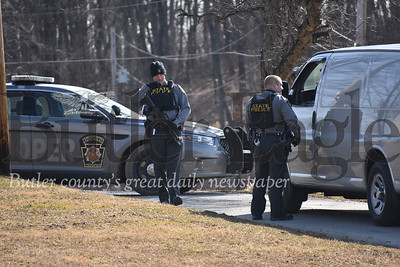 Heavily armed troopers with State Police Wednesday lockdown the area around Davis Road where a a 23-year-old man was killed in what police say was a homicide.photos by Eric Jankiewicz