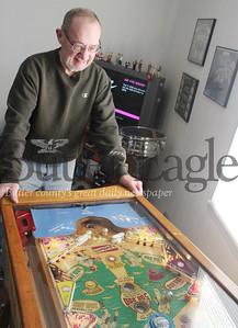 Pat Gallagher, 64, of Butler plays a Gottlieb's Sluggin Champ pinball machine manufactured in 1956.