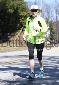 Mary White, 59, of Butler takes an afternoon jog along Vogel Road. White has completed 18 marathons and is currently training to run half-marathon in Mariane State Park.