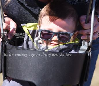 Six-month-old Colt Schultz prepares to take a ride on the swings at the Adams Township Community Park compliments of his mother, Krystal of Valencia.