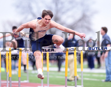 Harold Aughton/Butler Eagle: Butler sopohmore Byron Manchester sprints to the finish line in the (not sure) 100 m hurdles.
