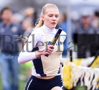 Butler's Liz Simms anchored the 4x8 relay for the win.