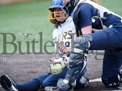 Harold Aughton/Butler Eagle: Knoch catcher Amanda Fisher tags out Mars Abby Gehr at home.