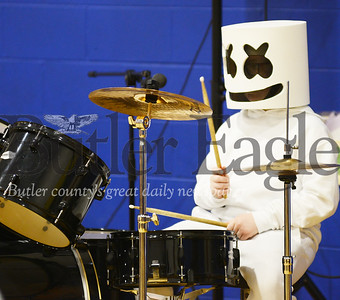 "Photo by Alexandria Mansfield. CUTLINE: Fifth-grader Lenny Splane performs a drum solo from the song ""Happier"" by Marshmello at Mars Centennial School's 12th annual talent show."