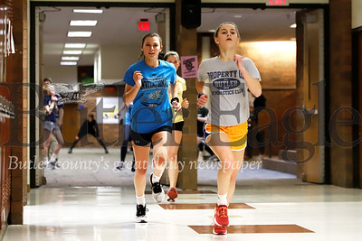 Butler mid-distance runners Krislyn Green (right, freshman) and Chloe Weiland (sophomore) run laps in the intermediate high school during indoor practice Feb. 11. Seb Foltz/Butler Eagle 02/11/20