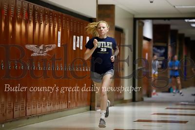 Butler senior distance runner Chelsey Kabel runs laps through the halls of the intermediate high school during indoor track practice. Seb Foltz/Butler Eagle 02/11/20