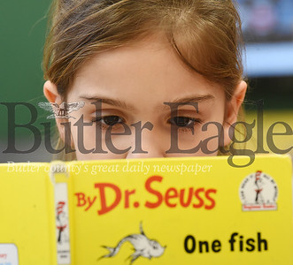 Harold Aughton/Butler Eagle: Butler Catholic first grader, Sophia Stegner, reads One fish, Two fish by Dr. Seuss during read across America day in Mr. Brian Herlihy's class Monday, March 2, 2020.