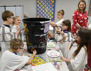 Harold Aughton/Butler Eagle: (left-right) Siblings Jackson,6, and Connor, 8, Meyer, joined Clara,8, and Jack, 11, Peterson as well as twin sisters Rachel, 9, and Krista Buzard in painting a rain barrel as part of a class designed for homeschoolers at the Zelienople Library while education coordinator Emily Huff, children's services coordinator watches on, Tuesday, March 3, 2020.