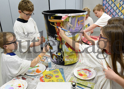 Harold Aughton/Butler Eagle: (left-right) Siblings Jackson,6, and Connor, 8, Meyer, joined Clara,8, and Jack, 11, Peterson as well as twin sisters Rachel, 9, and Krista Buzard of Cranberry to paint a rain barrel as part of a class designed for homeschoolers at the Zelienople Library, Tuesday, March 3, 2020.