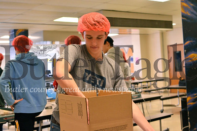 Clayton Pfeifer, a senior at Mars Area High School and the treasurer of the school's Key Club, packs meals in a box to be shipped to hungry people in developing countries. Pfeifer organized a Key Club food packing event Saturday in association with the group Rise Against Hunger. Tanner Cole/Butler Eagle