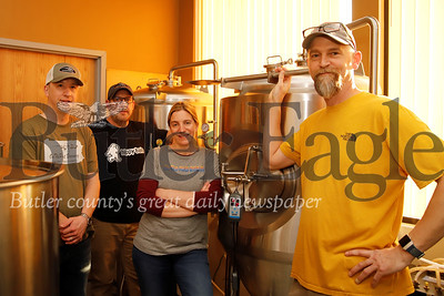 OnThePoint Brewing owners (left to right) Ross Marshall,  George Reese (brewer), Julie Breitenbach, and Matt Gollick. Seb Foltz/Butler Eagle