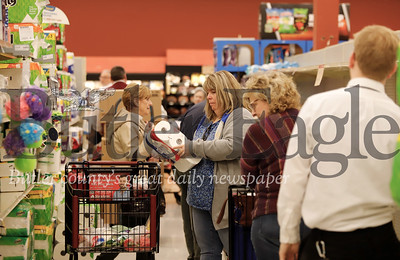 Customers at the Moraine Pointe Plaza Giant Eagle flock to the toilet paper aisle as staff restock items fresh off the truck. According to a Giant Eagle manager, the store is currently recieving 10 restock deliveries daily, up from their normal six daily delivery truckloads at that store as a result of increased demand. Seb Foltz/Butler Eagle