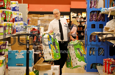 ob Bowser restocks paper towels at the Moraine Pointe Plaza Giant Eagle Friday. While  the store was well stocked in most departments, customers Friday were taking certain items, such as toilet paper, off the shelves almost as fast as they were being restocked. One Giant Eagle official said there was a direct correlation between items being sold and items being recommended for puchase buy national and local news media. Seb Foltz/Butler Eagle