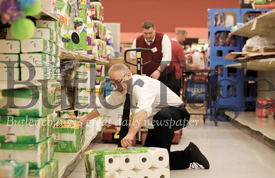 Bob Bowser restocks paper towels at the Moraine Pointe Plaza Giant Eagle Friday. While  the store was well stocked in most departments, customers Friday were taking certain items, such as toilet paper, off the shelves almost as fast as they were being restocked. One Giant Eagle official said there was a direct correlation between items being sold and items being recommended for puchase buy national and local news media. Seb Foltz/Butler Eagle