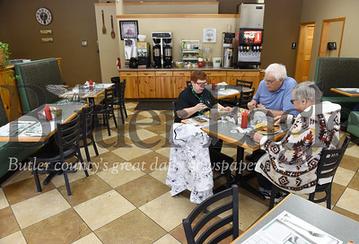 Harold Aughton/Butler Eagle: (From left) Cathy Tack of Butler Twp., WIlliam Rieger and Toni Rieger of Butler gather at Mac's Route 8 Cafe for lunch Monday, March 16, 2020. Sara Negley
