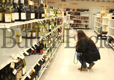 Cara Clouser of Cranberry shops for wine Wednesday at the Fine Wine & Spirits in Seven Fields. Seb Foltz/Butler Eagle