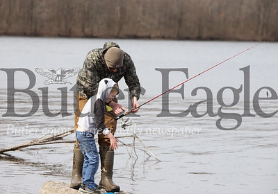 Jeff Lewis of Butler shows Dylan Chipps, 5, of Cranberry how to cast a fishing rod at Moraine State Park Wednesday. Chipps spent the morning at the park with his sister Mina Day-Connelly, 11, and  their grandfather Dayle Chipps (not pictured) Seb Foltz/Butler Eagle