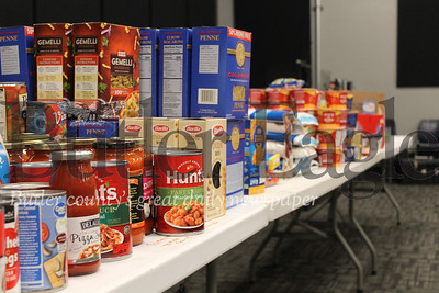 """""""Victory Family Church is distributing food to those in need during the pandemic. Food and cash donations are being collected from both individuals and organizations in the Cranberry Township region. Three tractor-trailer shipments of non-perishable foods were donated so far this week."""" Photo by Samantha Beal."""