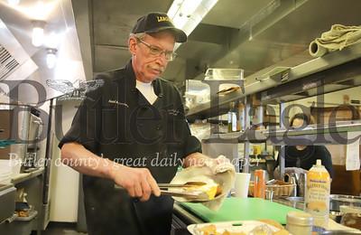 Hotel Saxonburg executive chef Alan Green prepares a fish sandwich for takeout Friday 03/20/20. Seb Foltz/Butler Eagle