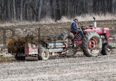 Harold Aughton/Butler Eagle: Beef farmer Guy Daubenspeck of Connoquennessing Twp. spreads cow manure on a 4 acre parcel of land in preparation of planting corn in the coming months. According to Daubenspeck the coronavirus has not interrupted his farm but has received increased calls from stores to purchase beef.