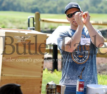 Harold Aughton/Butler Eagle: Mason Miller of Burgh Bees discusses the construction of a bee hive Saturday, July 27, 2019.